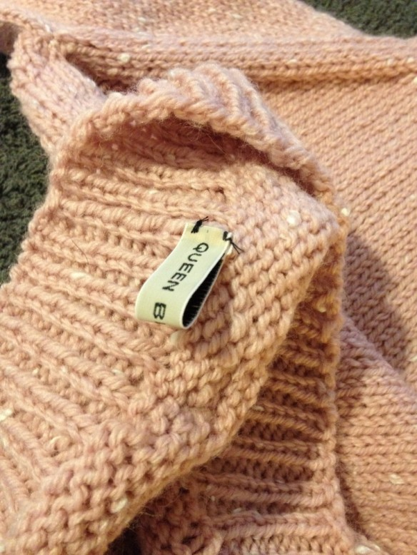 Queen Bee Knits label is placed on the inside of the bottom … don't want it rubbing baby's neck!